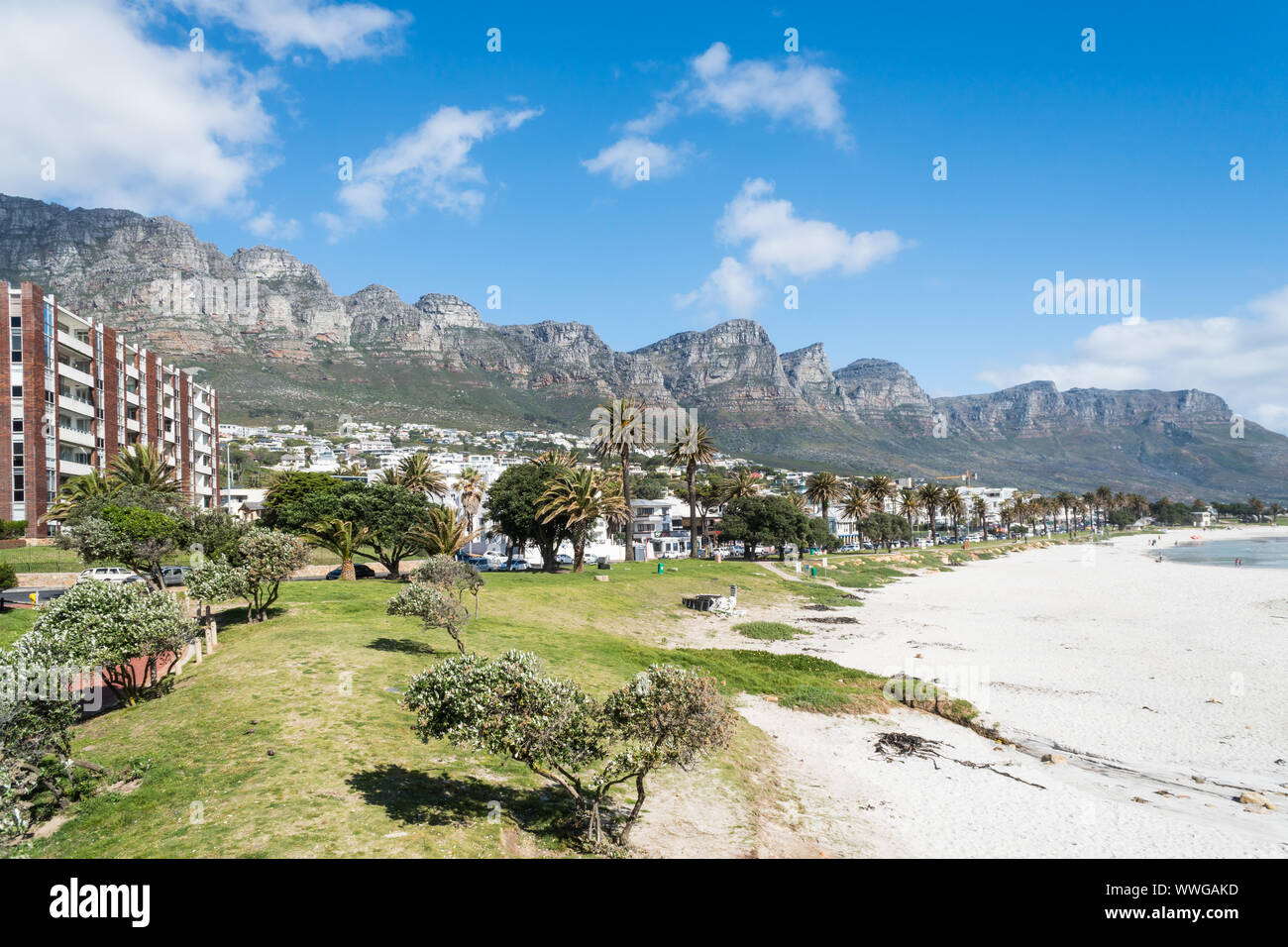 Camps Bay white sandy blue flag beach in Cape Town, South Africa scenic view onto the upmarket suburb with Twelve Apostle mountains in the background Stock Photo