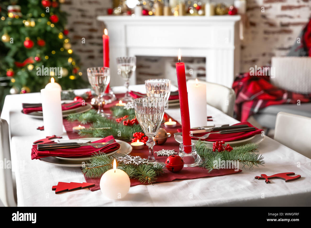 Beautiful Table Setting With Christmas Decorations In Living