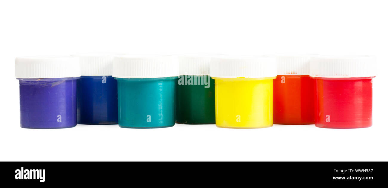 Closeup view colorful cans with gouache. Rainbow colors Stock Photo