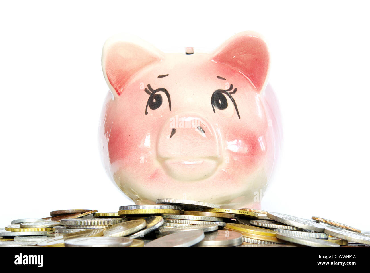 Pink piggy bank  isolated on white background with coins Stock Photo