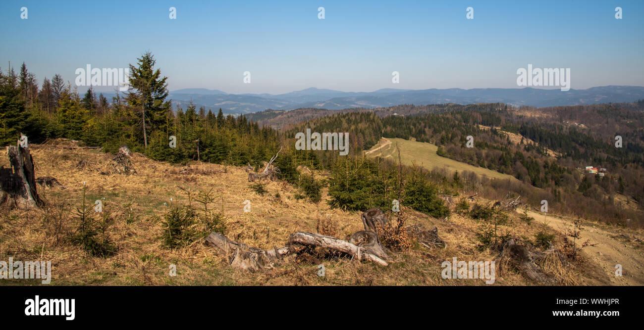 Turzovska vrchovina and Moravskoslezske Beskydy mountains panorama from Jakubovsky vrch hill in Javorniky mountains in Slovakia during nice springtime Stock Photo