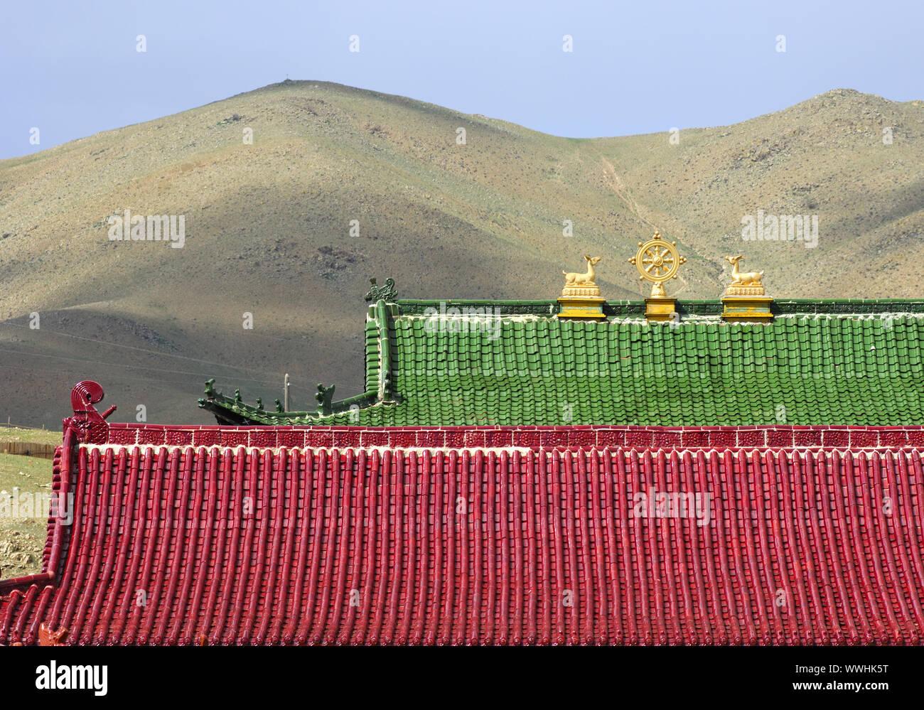 Buddhist symbols on a roof, Mongolia Stock Photo