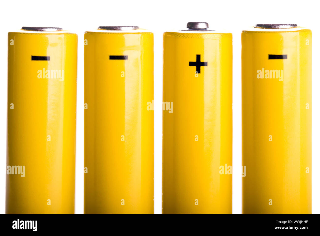 four yellow standing batteries Stock Photo