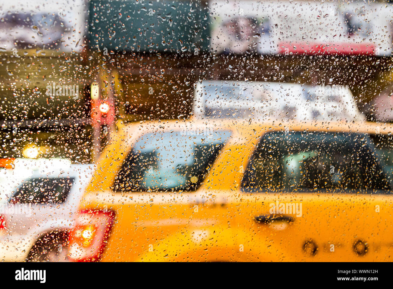 Taxi on a New York street through a rain soaked window Stock Photo