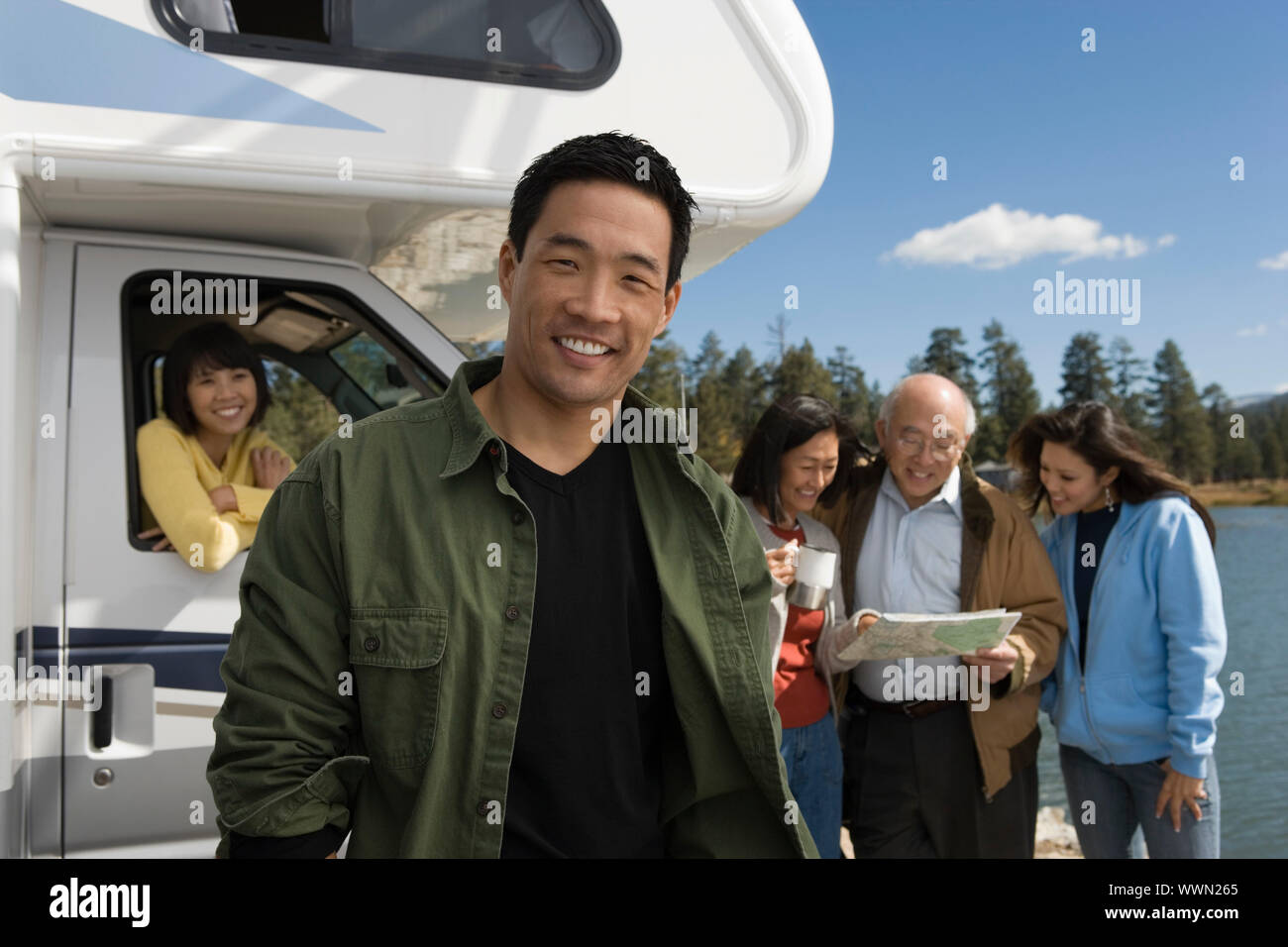 Man and His Family on Vacation Stock Photo