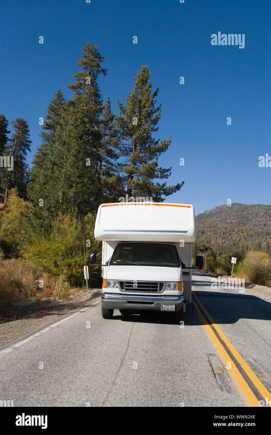 RV Driving on Mountain Road Stock Photo