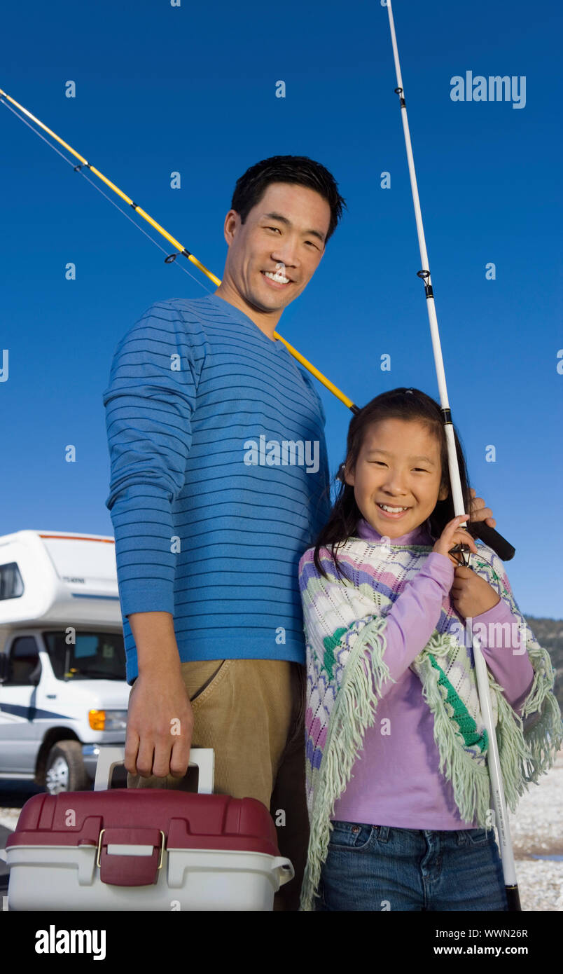 Man and Girl Going Fishing Stock Photo