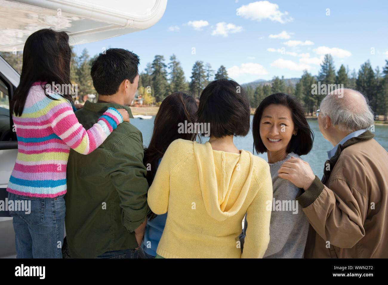 Family Looking at Lake Stock Photo