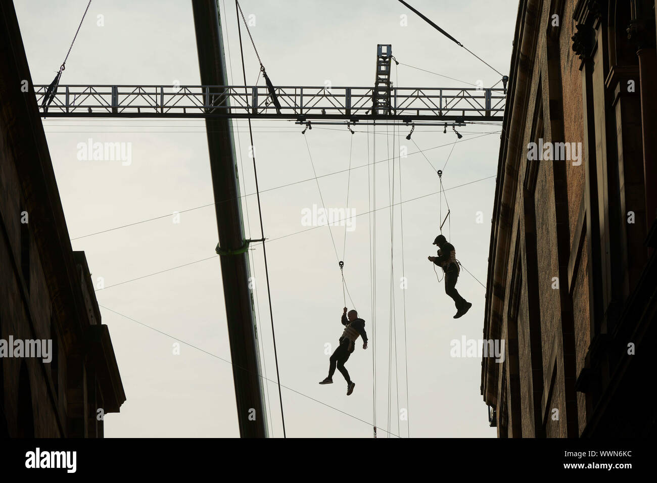 Edinburgh    September  16 2019;  A Fast and Furious 9 stuntman between the National Museum of Scotland and Edinburgh University.  The stuntman is attached to cables and appears to jump between the buildings.credit steven scott taylor / alamy live news Stock Photo