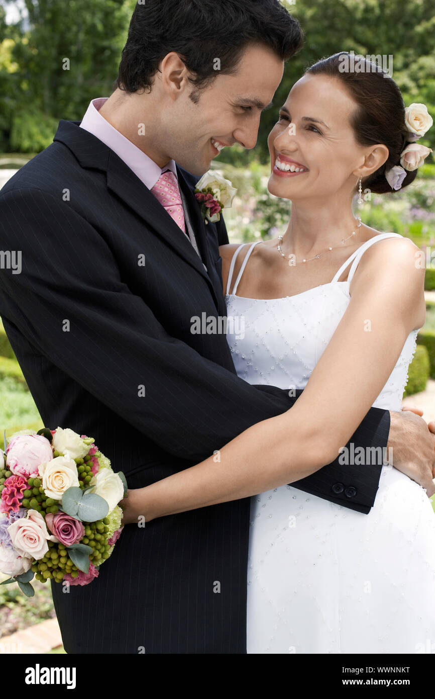Happy Bride and Groom Hugging Stock Photo