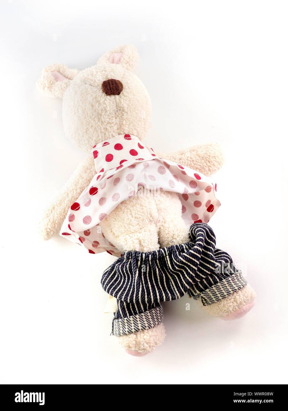 Rabbit doll that was stripped of clothes on white background. statutory rape concept Stock Photo