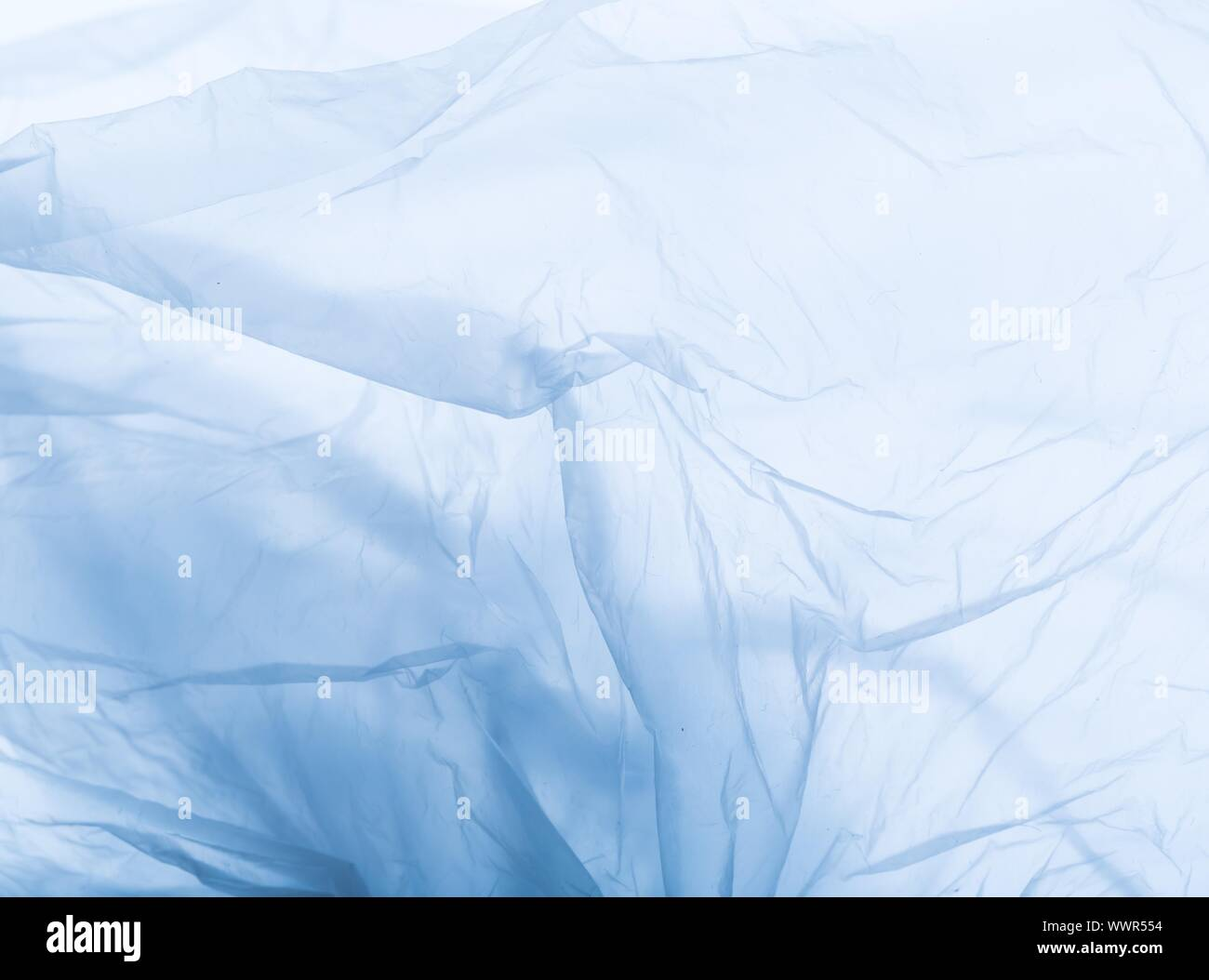 Abstract of plastic foil useful as background. Close up of creased plastic foil bag. Stock Photo