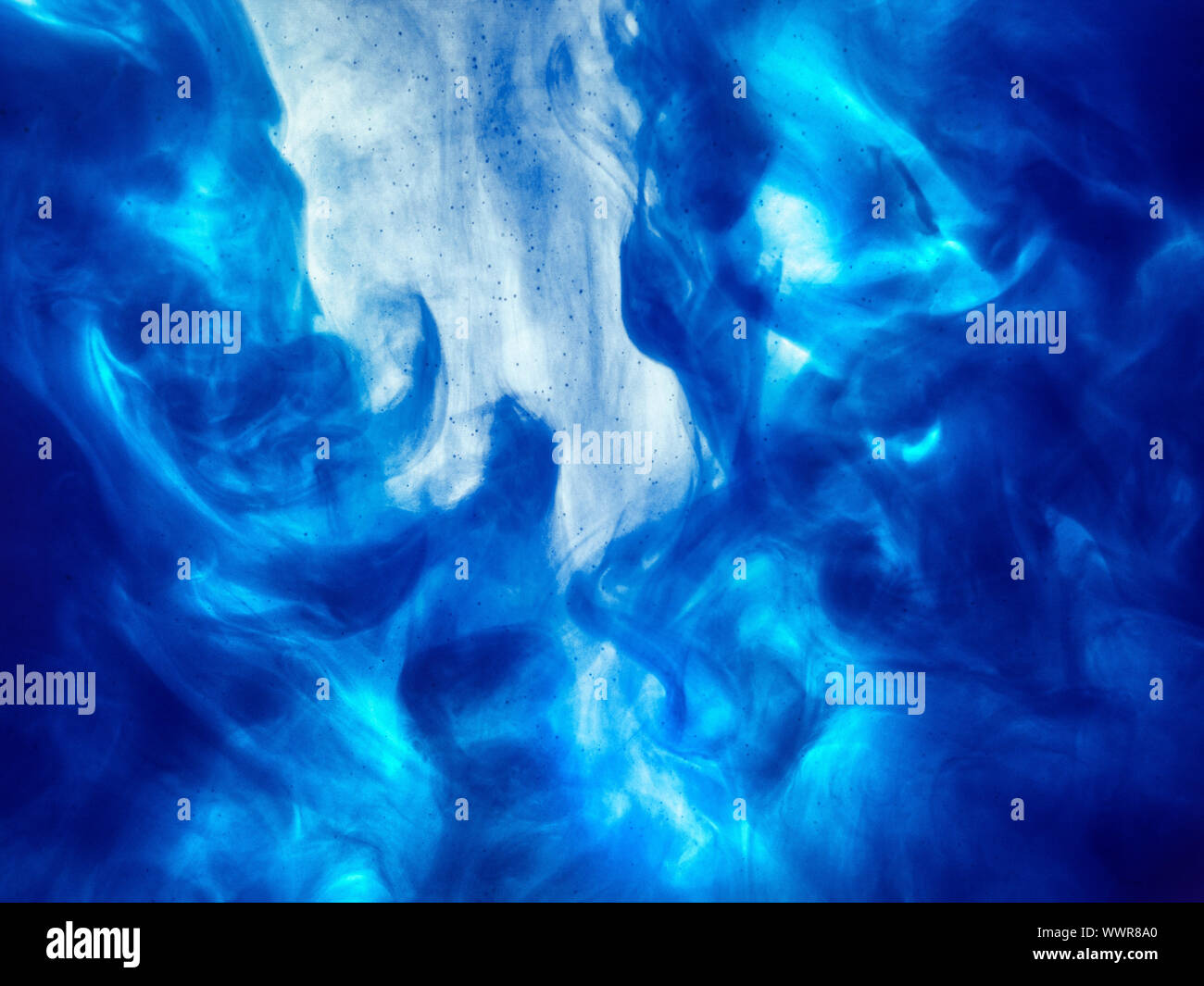 Poster color in water. Abstract background., Color paint drops in water. Ink swirling underwater, Cloud of silky ink collision, abstract smoke explosi Stock Photo