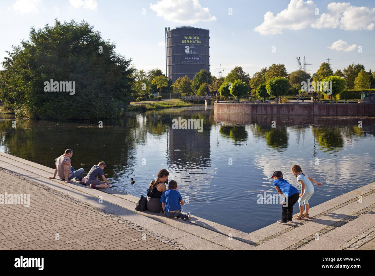 people at the Centro park with Gasometer, Oberhausen, North Rhine-Westphalia, Germany, Europe Stock Photo