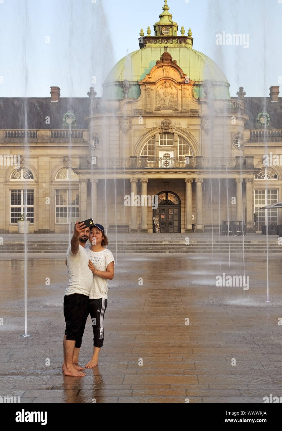 Couple makes a selfie in front of the the imperial palace, Bad Oeynhausen, Germany, Europe Stock Photo
