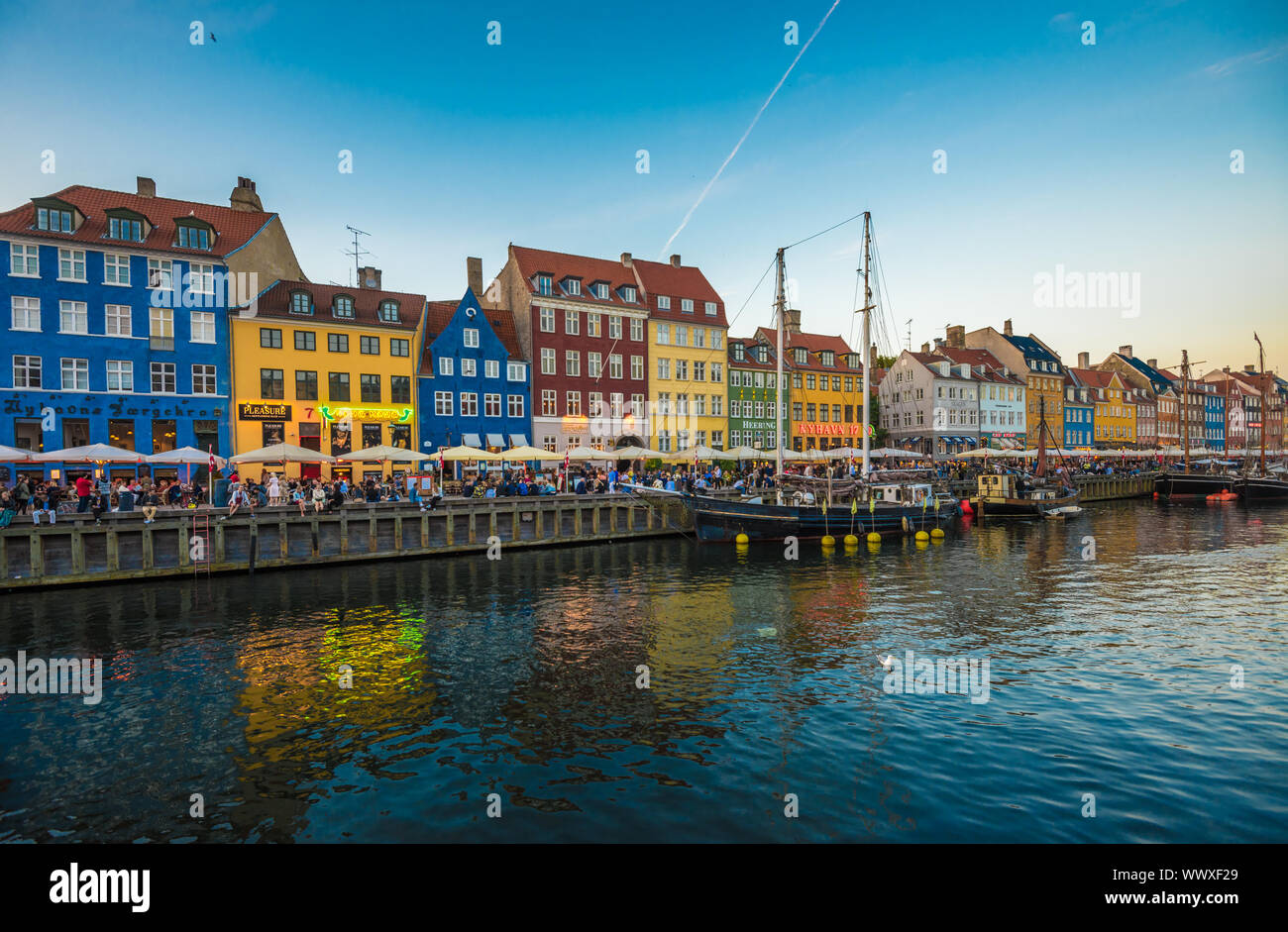 Nyhavn district is one of the most famous landmarks in Copenhagen, Denmark Stock Photo