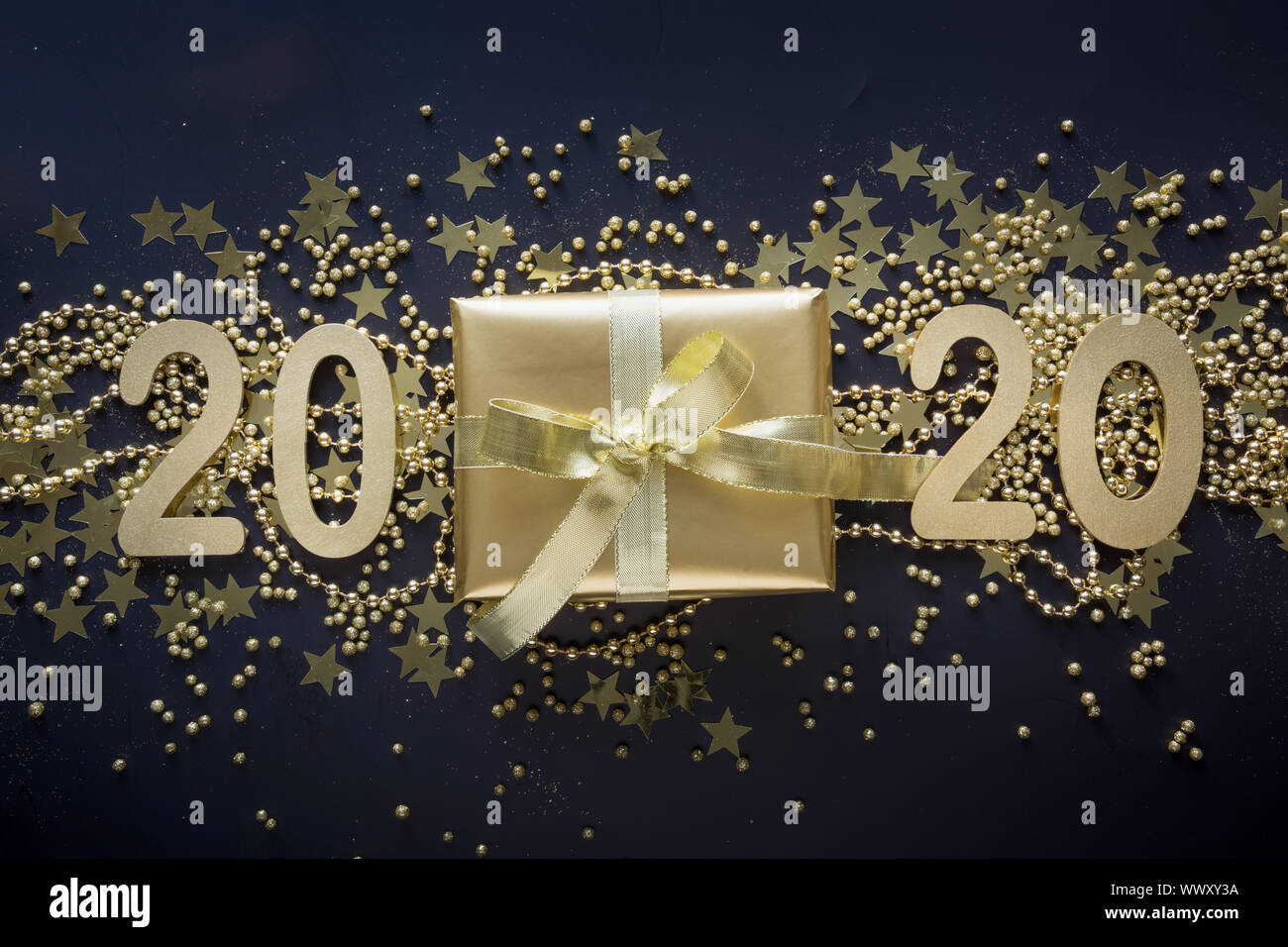 Present Christmas 2020 Luxury golden gift box with gold ribbon on shine black background