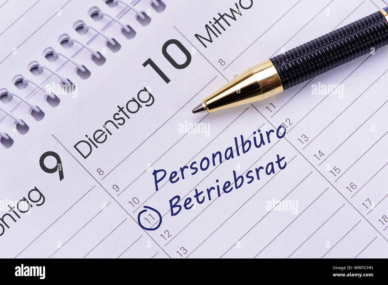 Date in calendar for works council in personnel office Stock Photo