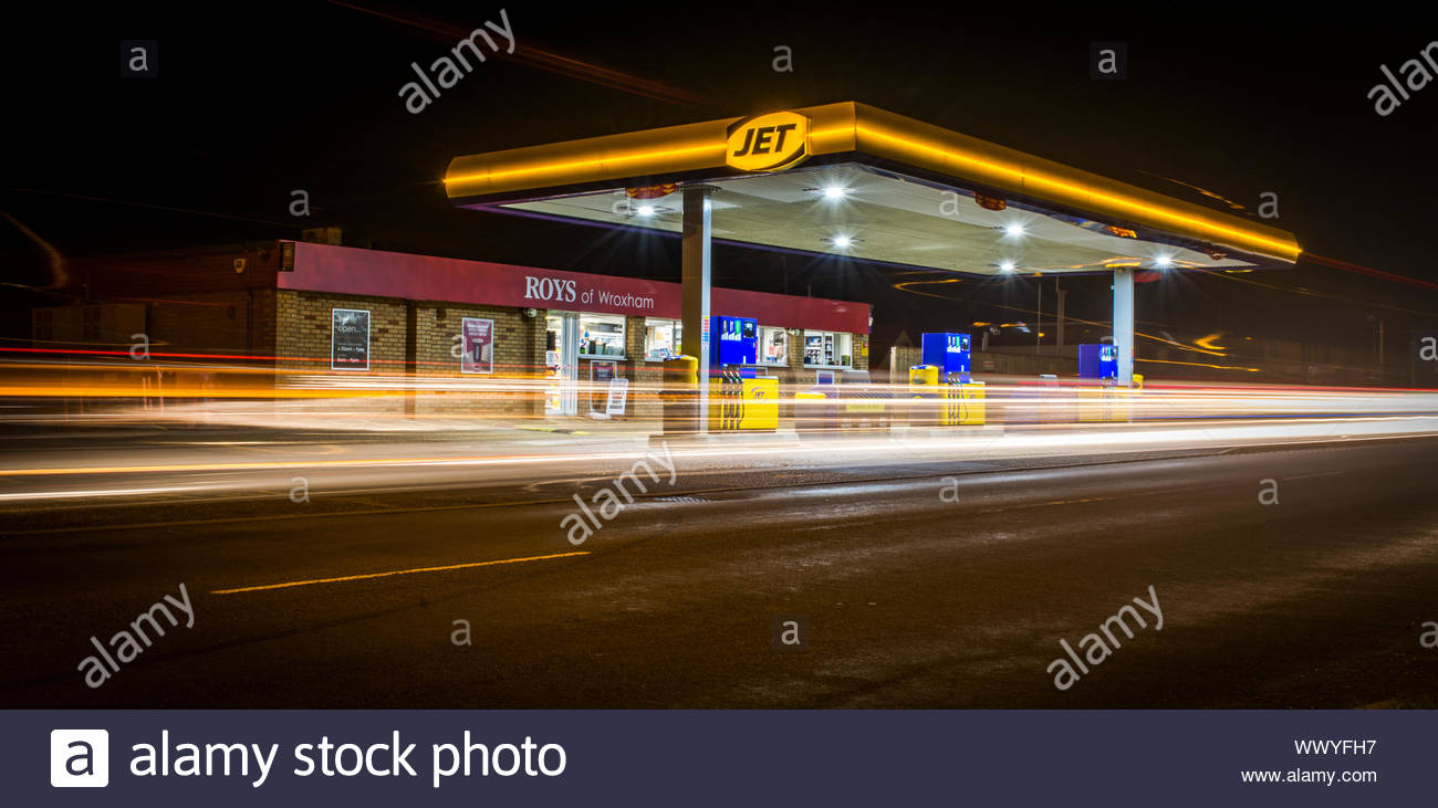 The Fuel Station In Wroxham All Lit Up At Night There Are No Cars On The