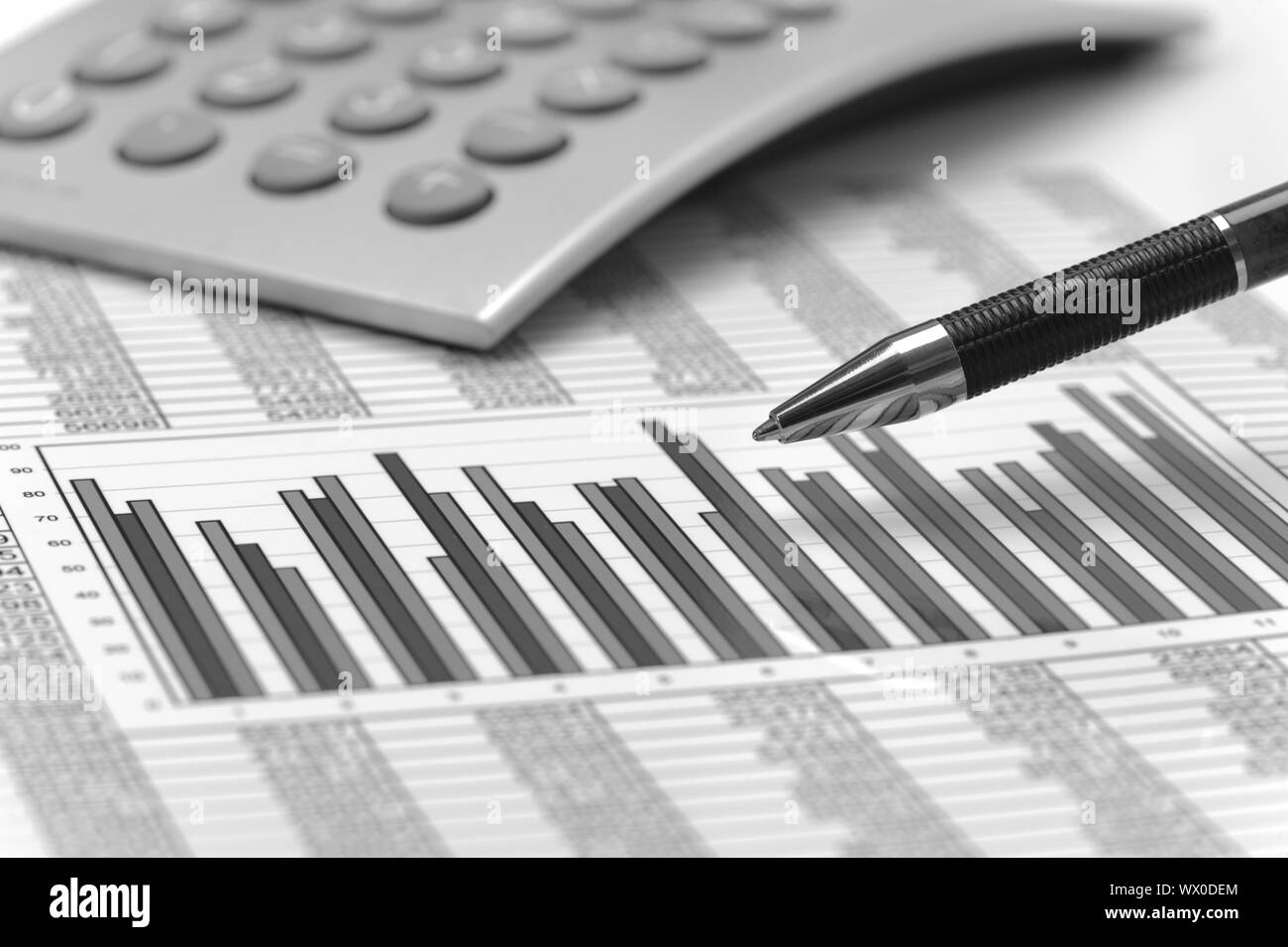 calculator and pencil laying on financial business chart Stock Photo