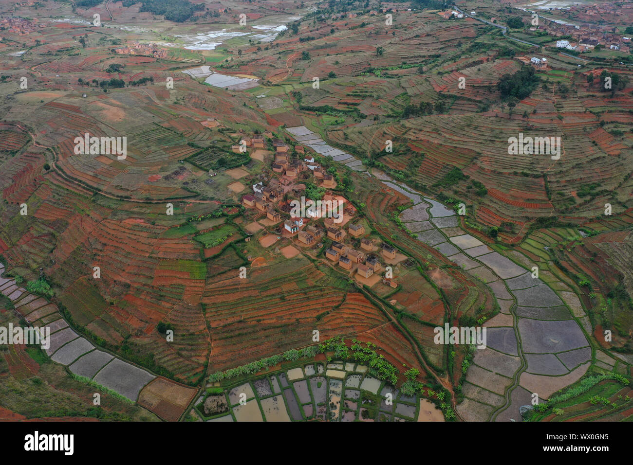 Rice fields and small villages near Ivato, Ambositra district, National Route RN7 between Ranomafana and Antsirabe, Madagascar, Africa Stock Photo