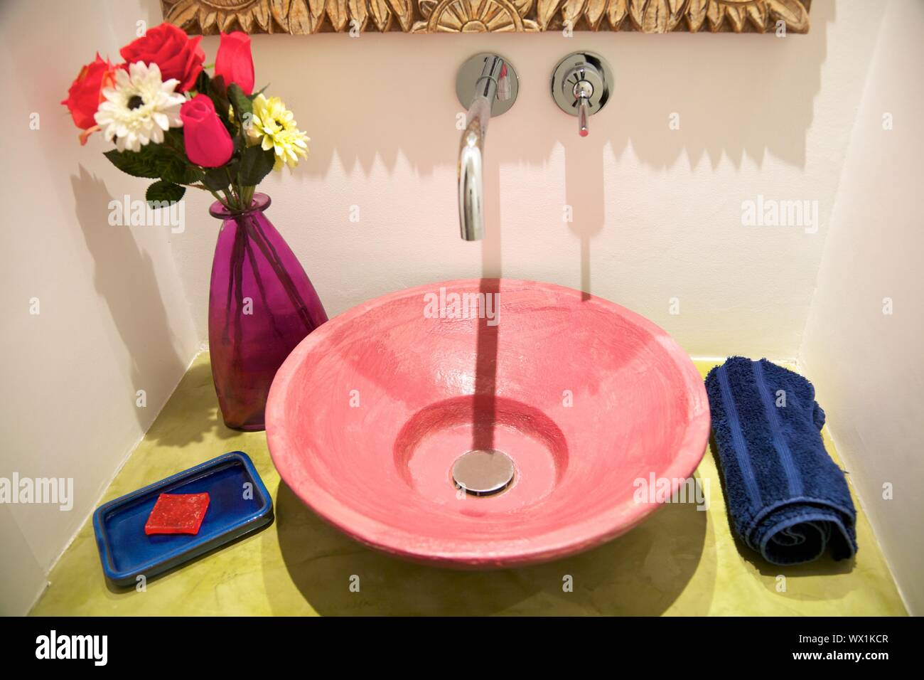 washbasin on green table and decoration in bathroom Stock Photo