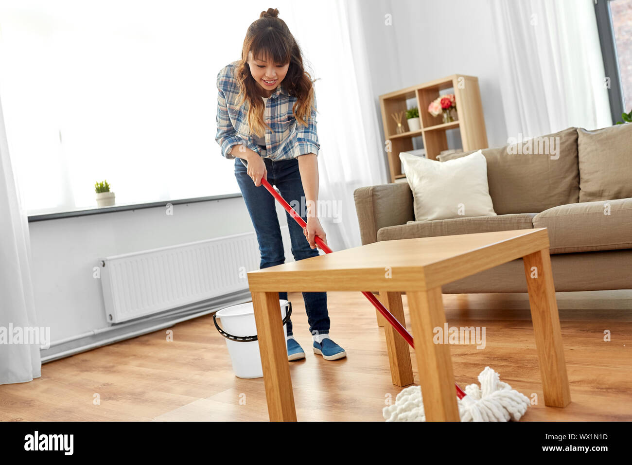 woman or housewife with mop cleaning floor at home Stock Photo   Alamy
