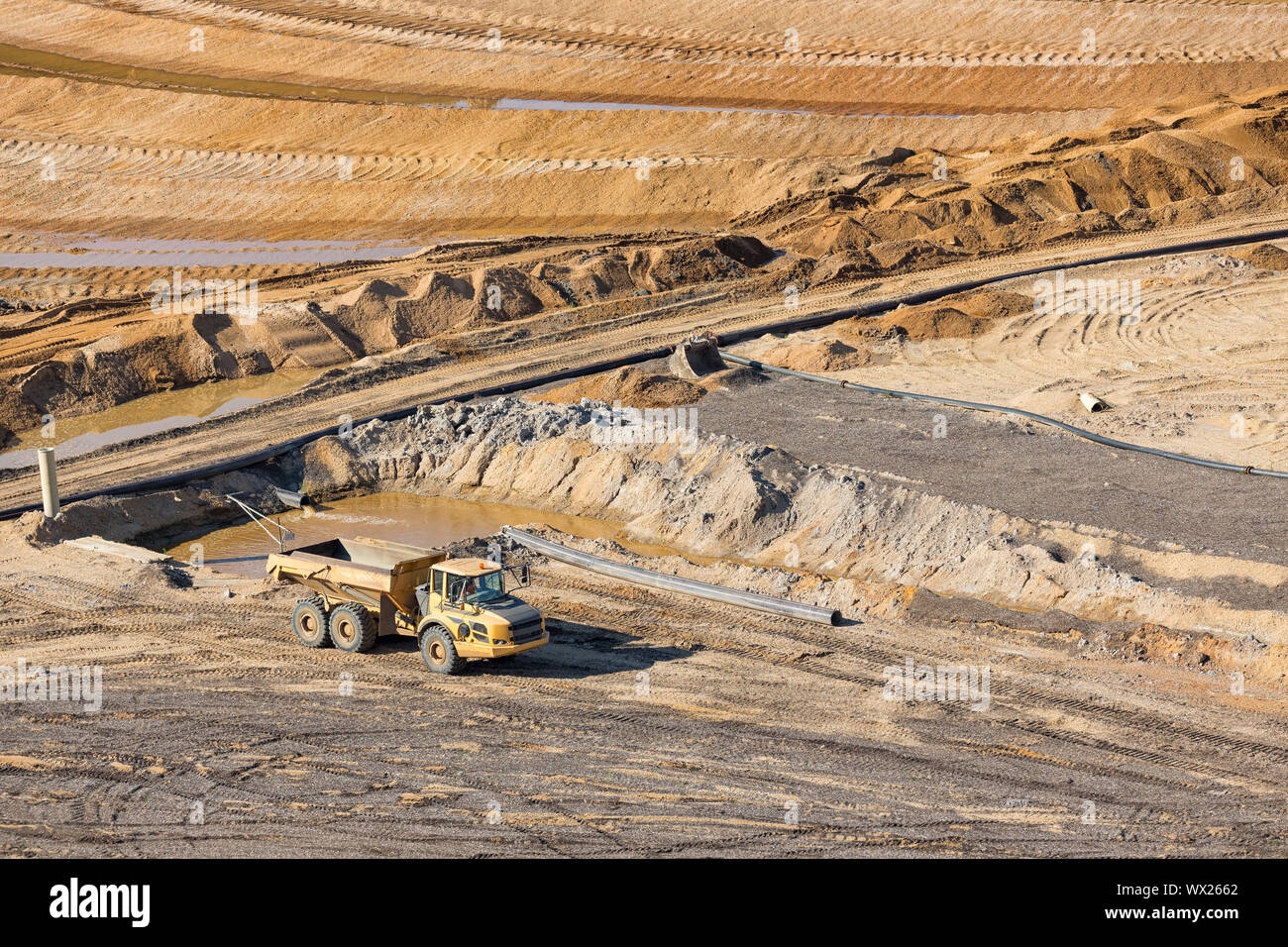 Tipping trailer in brown coal open pit landscape in Germany, Stock Photo