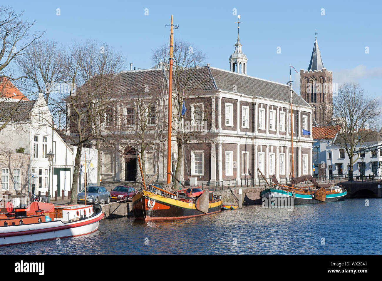 Traditional wooden barges in old historic harbor of Schiedam, The Netherlands Stock Photo