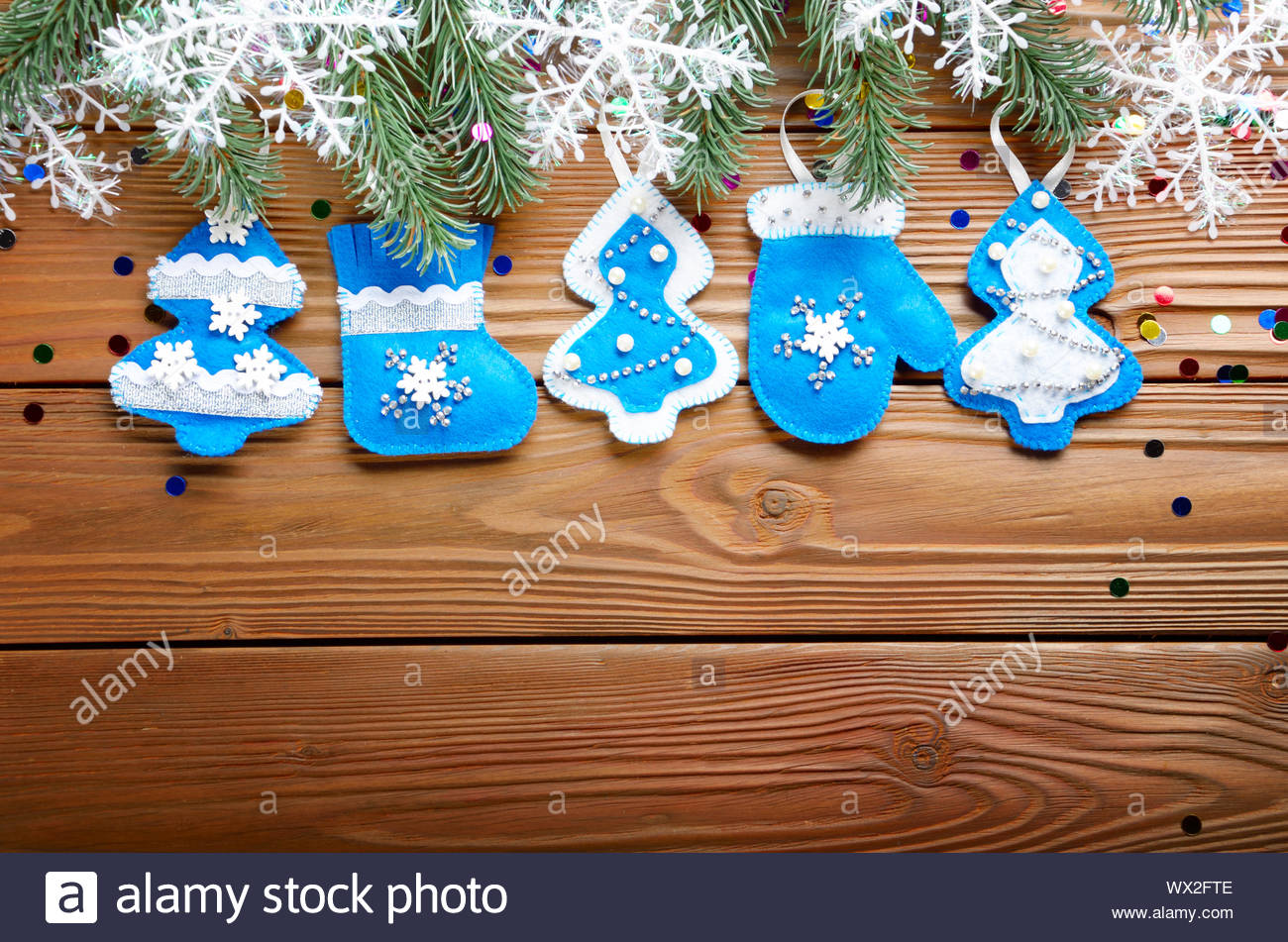 Flat Handmade Rustic Felt Christmas Tree Decorations As Background On Wooden Table Place For Text Stock Photo Alamy