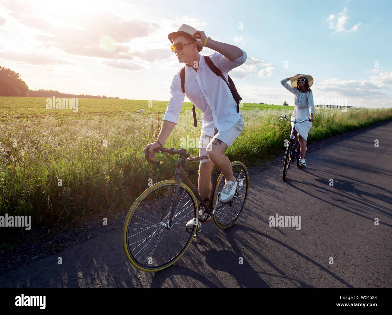 Young couple has a bicycle trip at summer countryside Stock Photo