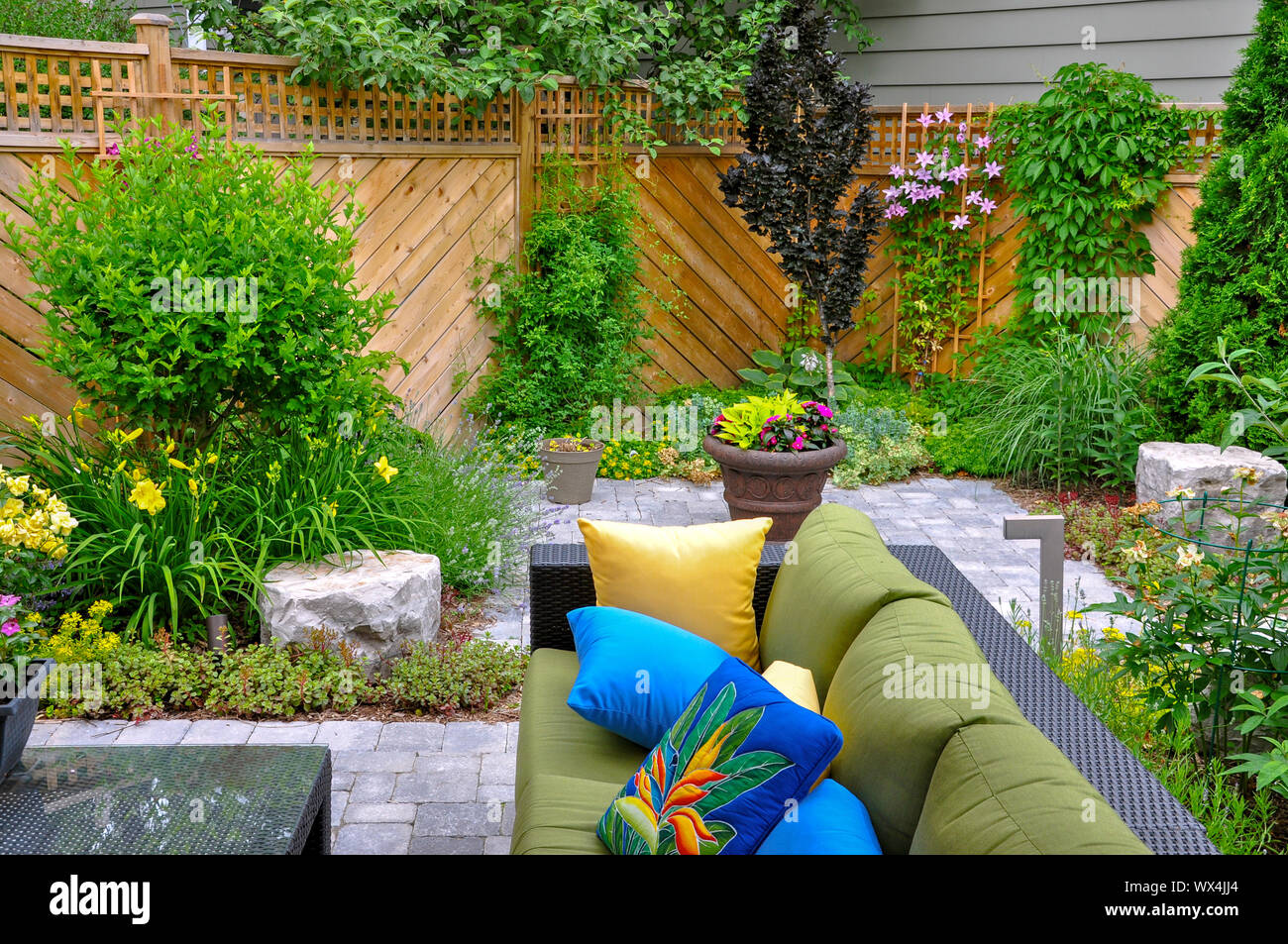 This Beautiful Small Urban Backyard Garden Features A Tumbled
