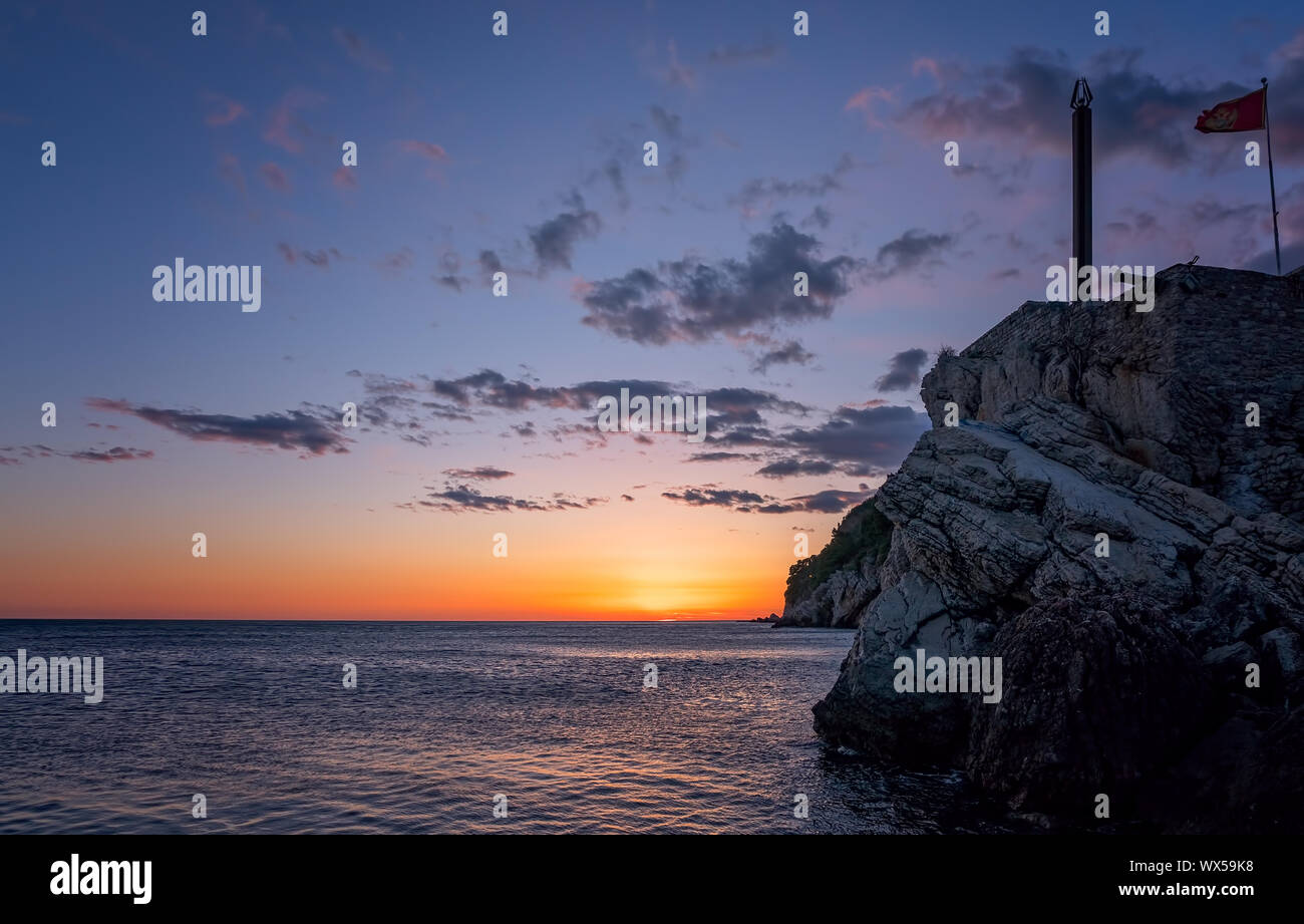 Obelisk and flag on the cliffs at dusk Stock Photo