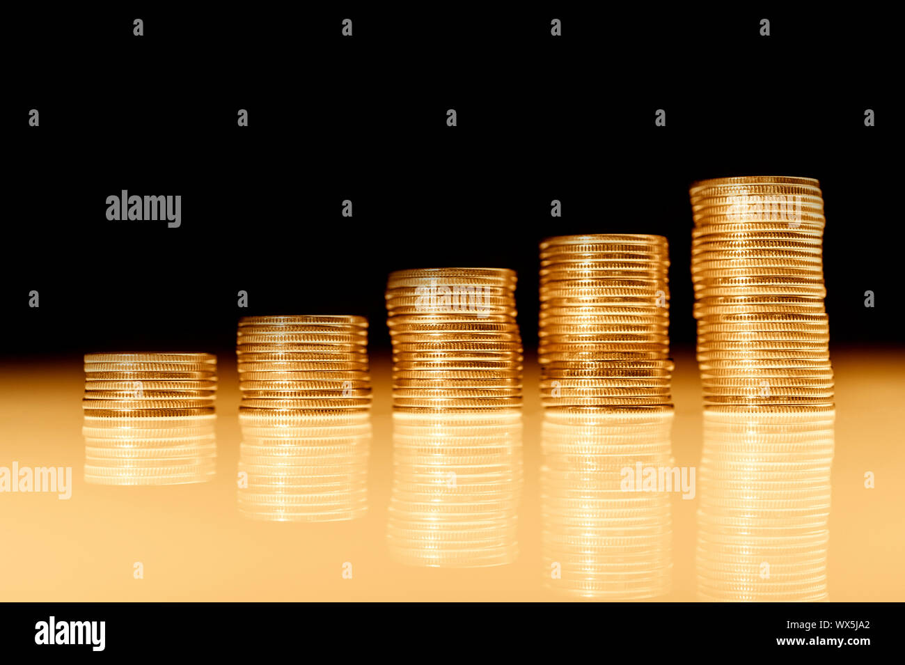 Stack of gold coins macro. Rows of coins for finance and banking concept. Economy trends background. Stock Photo