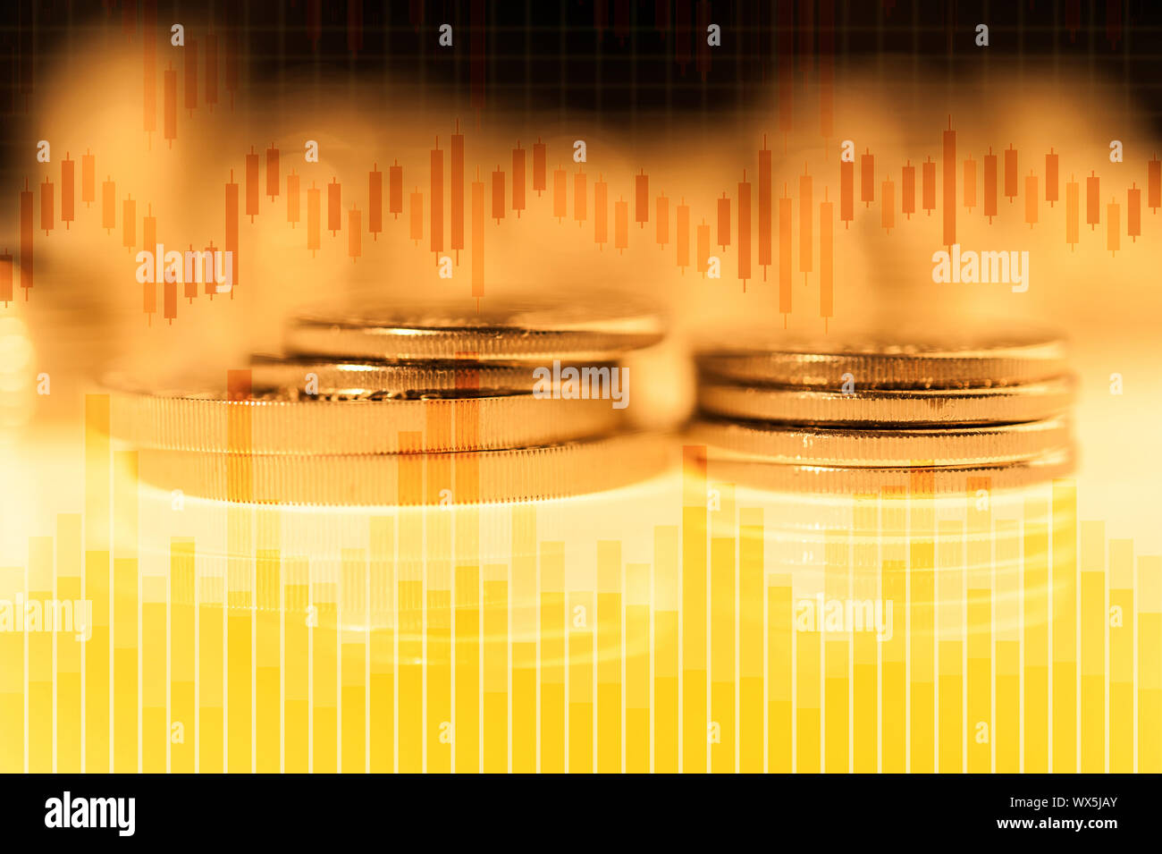 Graph and rows of gold coins for finance and business concept. Trade in precious metals. Stock Photo