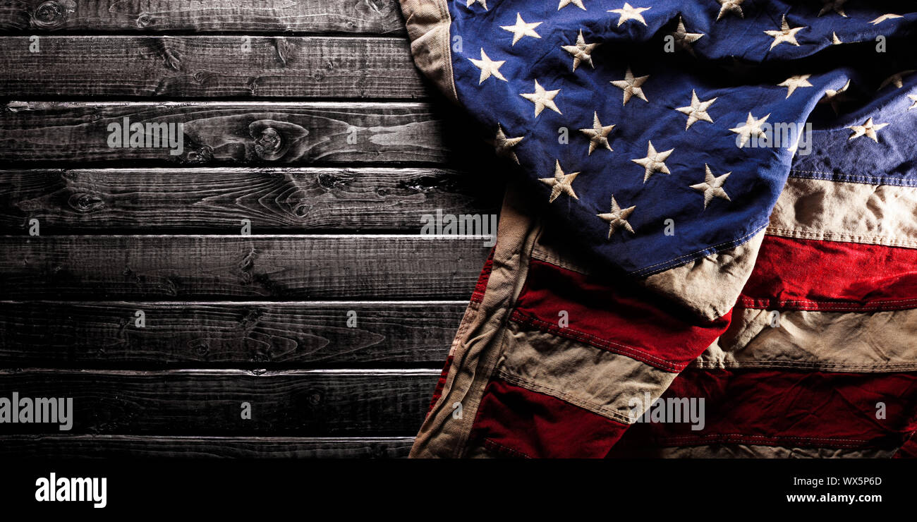 Tattered American Flag with Wood Background