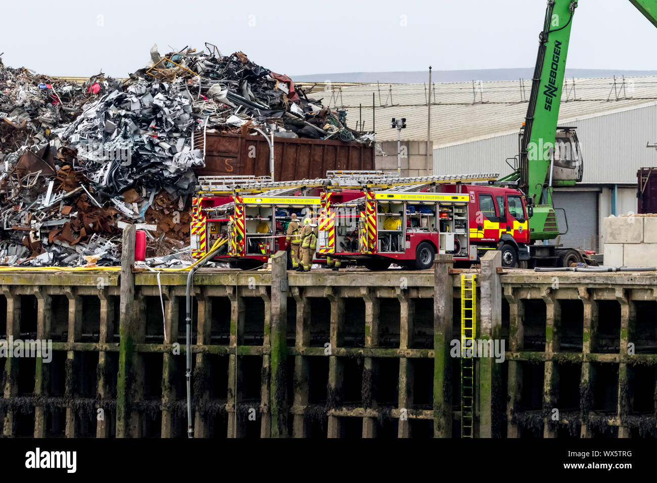 Newhaven, East Quay, East Sussex, UK. 16th September 2019. East Sussex fire and rescue service tackle a blaze at Ripley and Co scrap metal plant. Credit: Alan Fraser/Alamy Live News Stock Photo