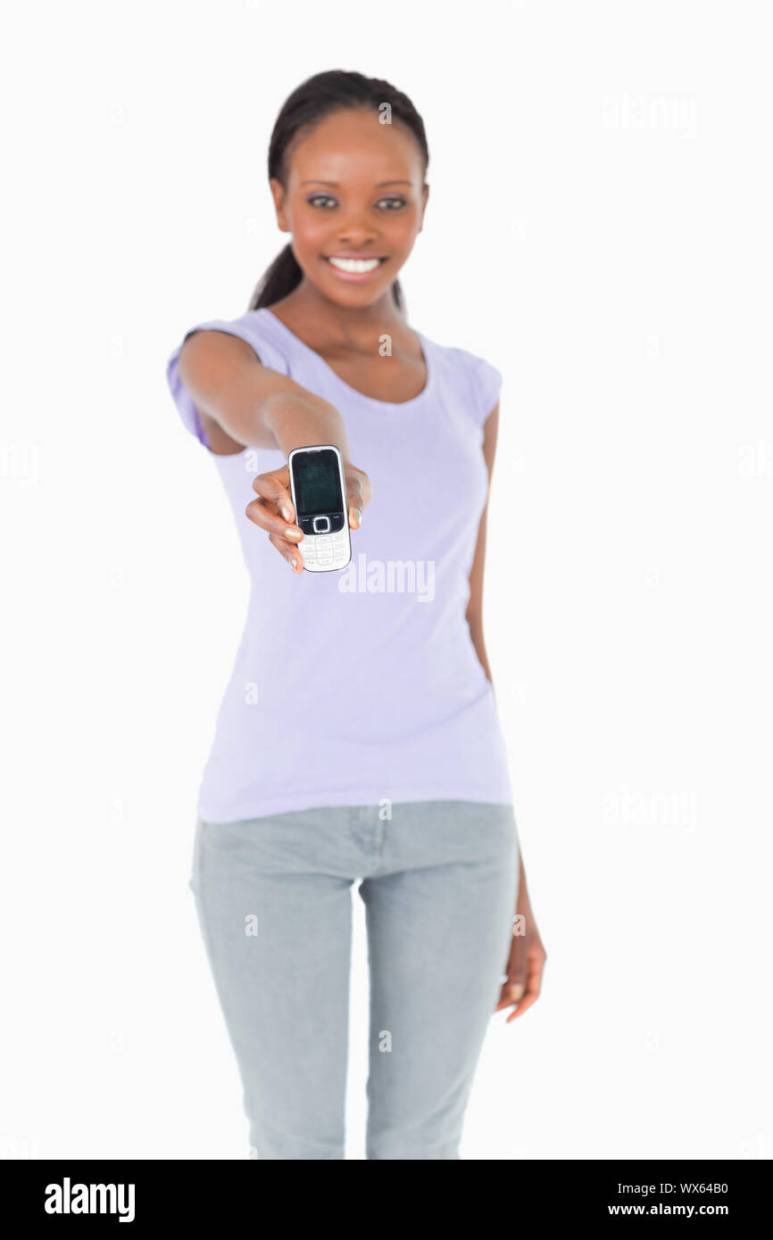 Close up of phone being presented by smiling woman on white background Stock Photo