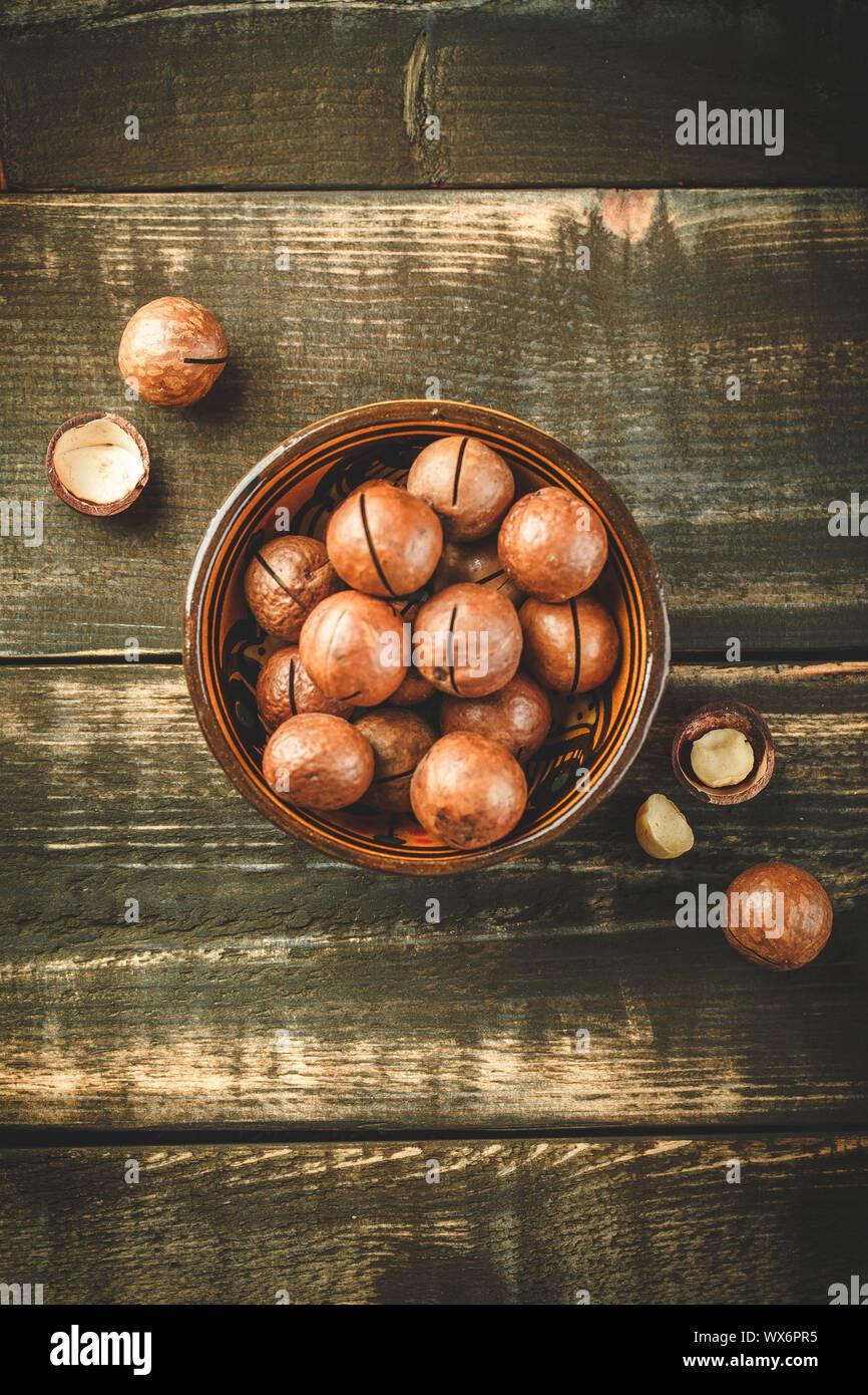 Macadamia nuts on wooden table Stock Photo