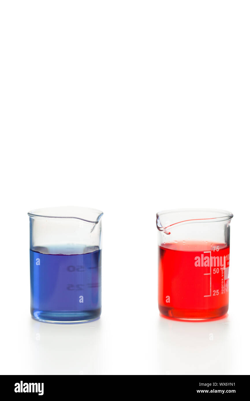 Blue and red liquid in beakers on a white background Stock Photo