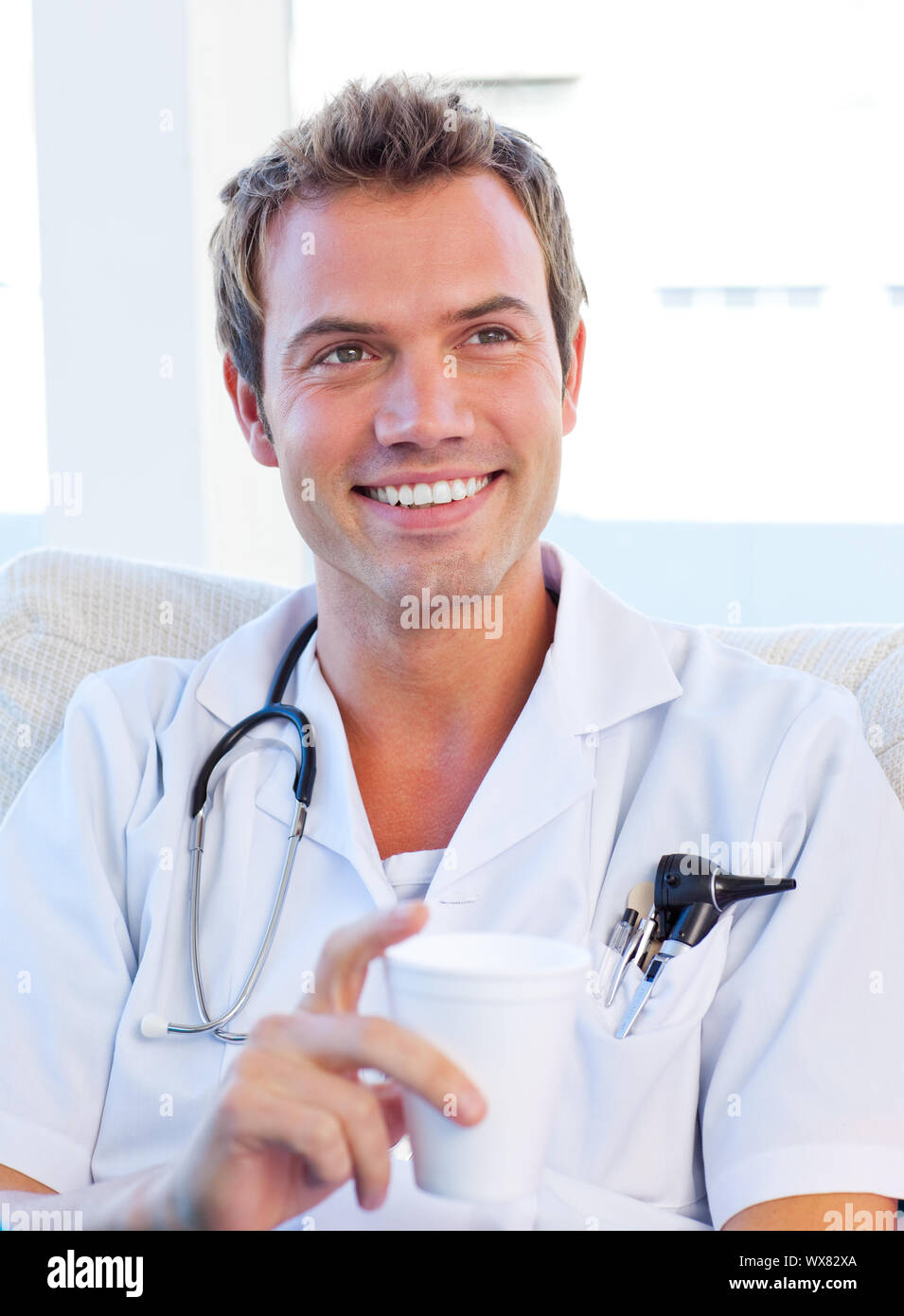 Charismatic doctor having a break in the staff room Stock Photo