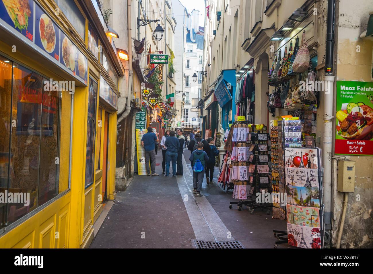 PARIS, FRANCE - 02 OCTOBER 2018: People walking on the narrow street in latin quarter in Paris. Stock Photo