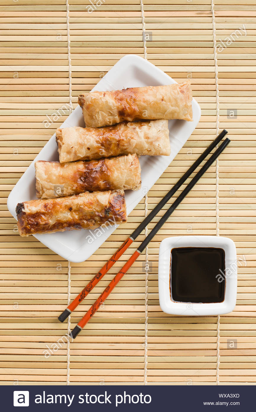 spring rolls on the reed placemats Stock Photo