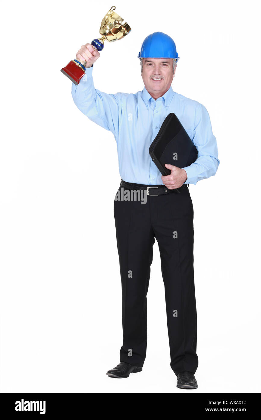 Engineer with a gold cup Stock Photo