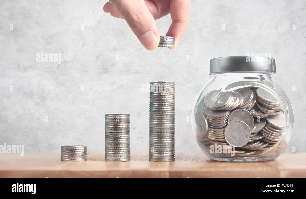 Dropping Coins Into Glass Jar Labeled Retirement Business Ideas Stock Photo Alamy