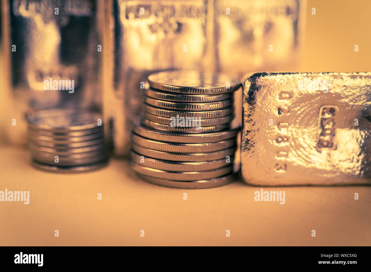 Gold bars and stack of gold coins. Background for finance banking concept. Trade in precious metals. Stock Photo