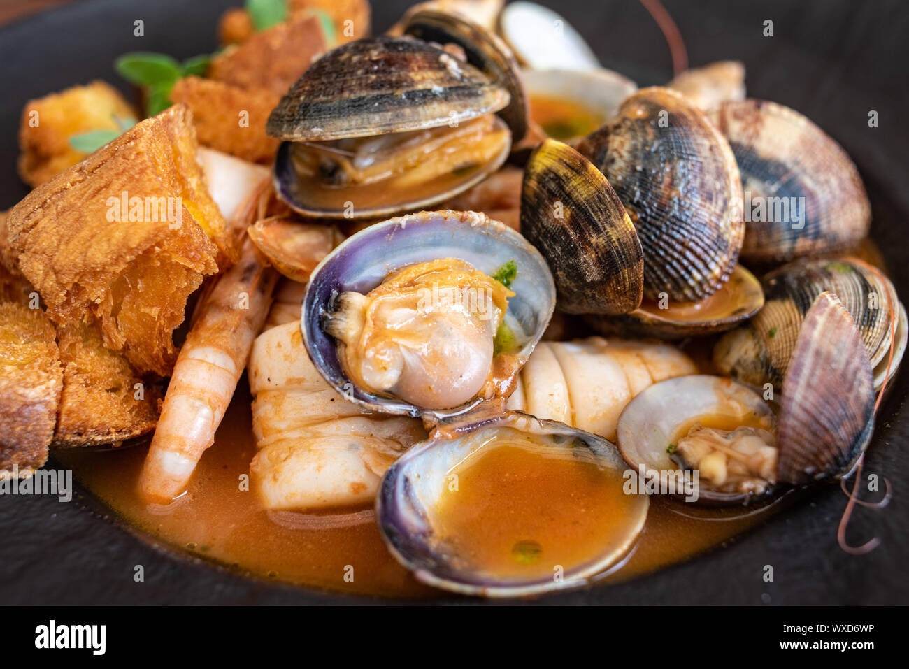 Fish soup, typical seafood dish of Italian cuisine. Stock Photo