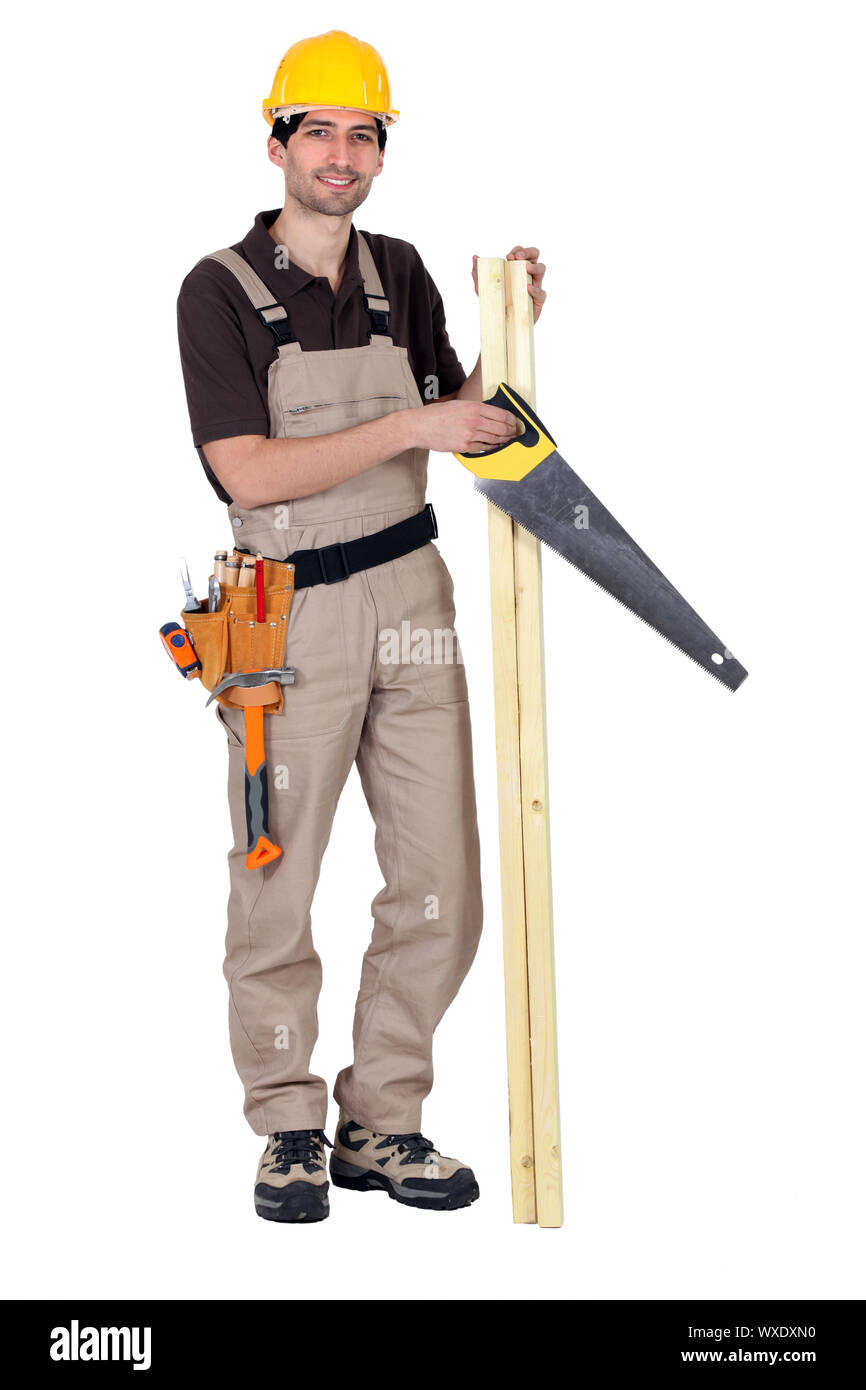 Worker holding plank of wood and hand-saw Stock Photo