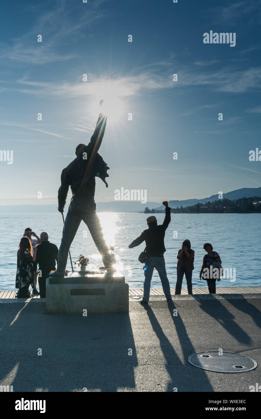 Montreux, VD / Switzerland - 31 May 2019: tourists visiting the Freddie Mercury Memorial Statue on t Stock Photo