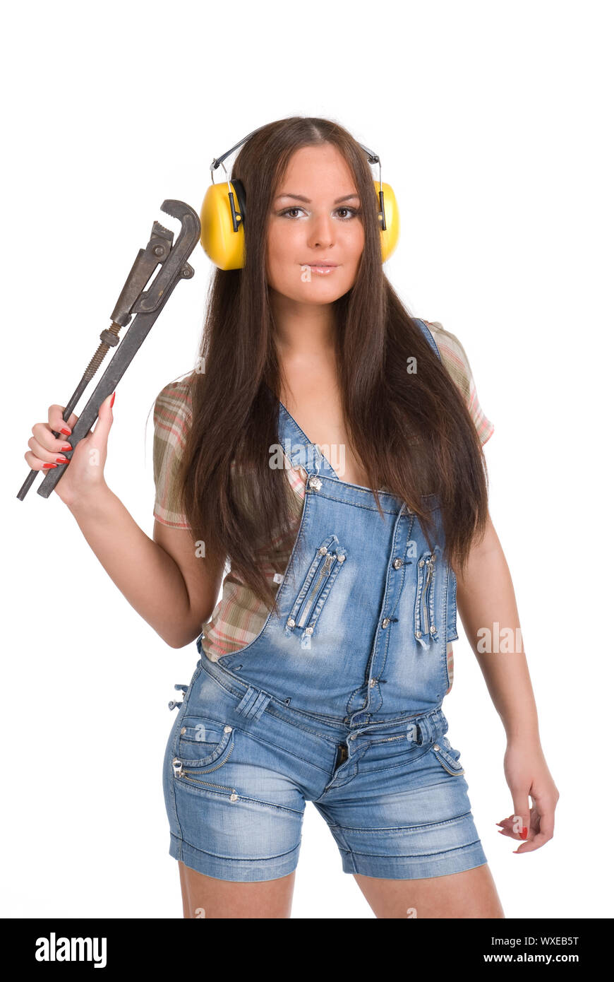 Young woman holding big wrench Stock Photo